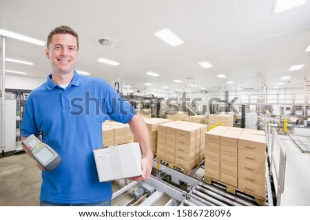 Portrait Of Worker Using Scanner In Warehouse Dispatch Area