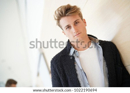 Portrait of 20-year-old student standing in hall #1022190694
