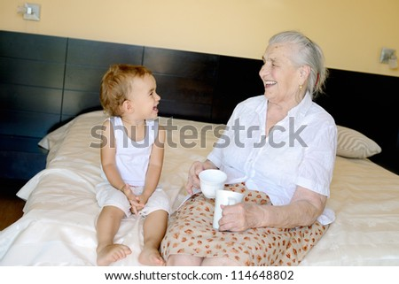 Portrait of 1,5 years old baby and and her 91,5 years old great grandmother