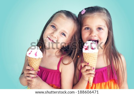 Portrait Of 5 Years Old Kid Girls Eating Tasty Ice Cream Over Blue 188606471