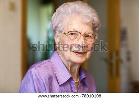 Portrait of 91 years old woman in her flat #78010108