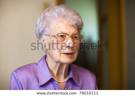 Portrait of 91 years old woman in her flat #78010111