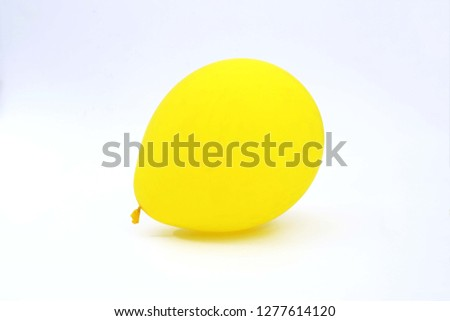 Portrait of yellow balloon. Isolated on the white background.