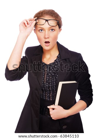 portrait of youn girl in glasses with books looking shocked