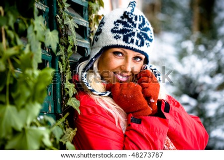 portrait of young a woman in front of winter forest