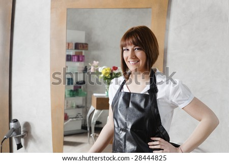 portrait of young adult hairstylist looking at camera