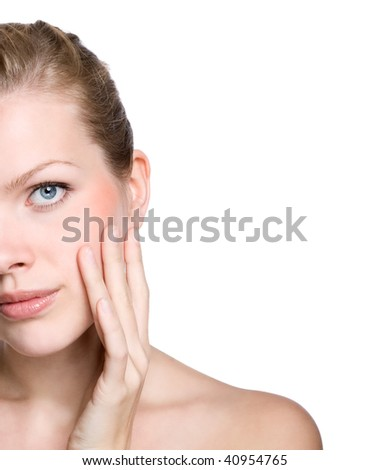 Portrait of young adult woman touching with her hand the healthy skin