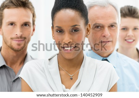Portrait Of Young African American Businesswoman With Business Team