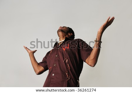 Portrait of young african american man with open arms