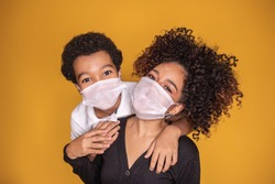 Portrait of young African American mother with toddler son using mask. mother and son wearing mask to protect covid 19, quarantine. Stay at home concept.