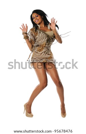 Portrait of young African American woman jumping isolated over white background