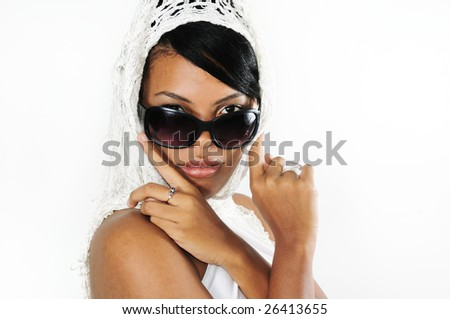 Portrait of young african american woman wearing sunglasses isolated