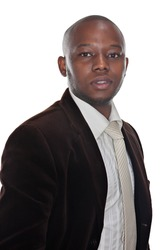 portrait of young african businessman in formal clothing