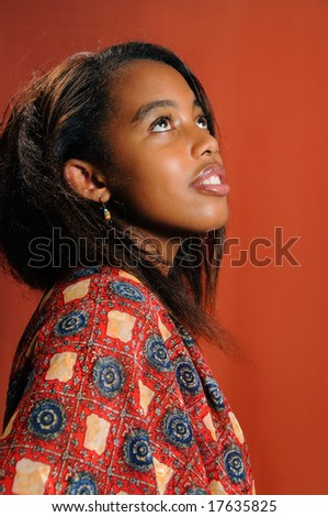 Portrait of young african female model posing