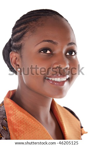portrait of young african girl with orange, brown top