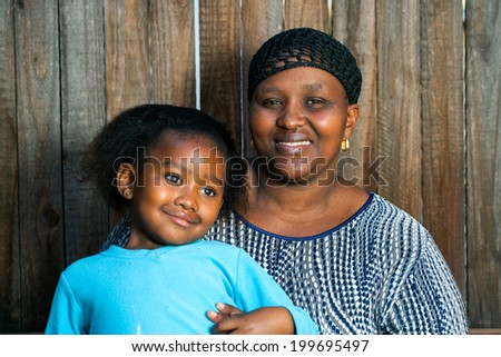 Portrait of young African mother with little daughter.