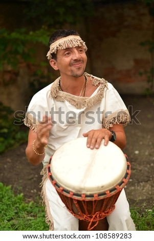 Portrait of young african percussionist performing live