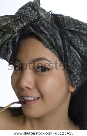 Portrait of young and beautiful Asian woman wearing a head scarf