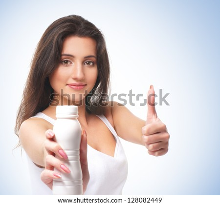 Portrait of young and healthy brunette over the blue background