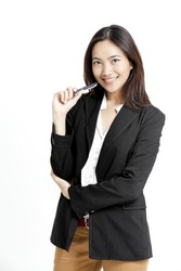 Portrait of young and smart businesswoman with a pen in her hand