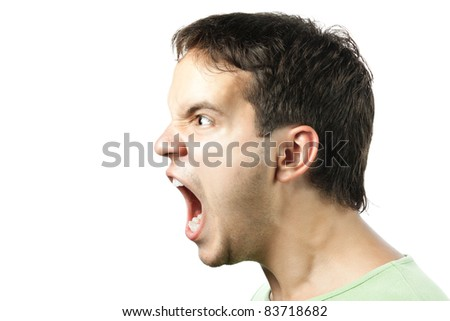 portrait of young angry man sreaming isolated on white background