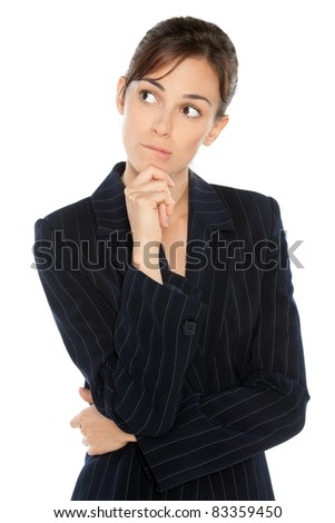 Portrait of young anxious businesswoman in suit biting her lip, looking sideways, isolated on white background
