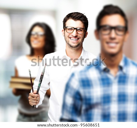portrait of young art students holding books indoor