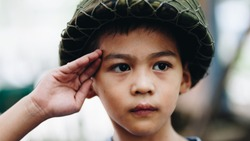 Portrait of young Asian children in Soldier uniform