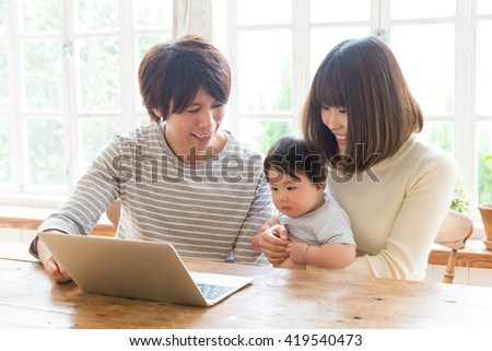 portrait of young asian family using laptop computer #419540473