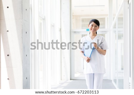 portrait of young asian nurse in hospital