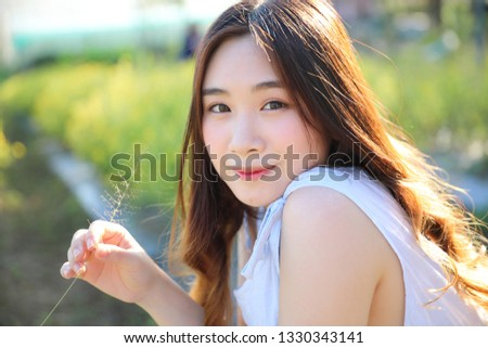 Portrait of Young Asian woman girl smile in flower garden #1330343141