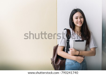 Portrait of Young Asian woman student with  laptop, Student and tutoring education with technology concept.