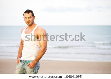 Portrait of young athlete on beach