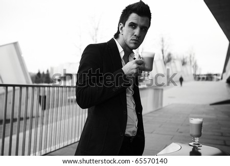 Portrait of Young attractive businessman drinking coffee