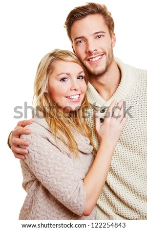 Portrait of young attractive couple looking into the camera
