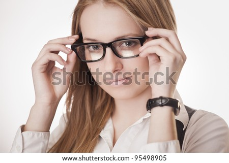 Portrait of young attractive girl in glasses