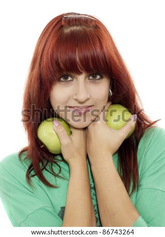 Portrait of young attractive girl with green apple