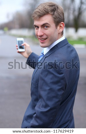 Portrait of young attractive man calling by phone