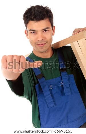 Portrait of young attractive Nepalese carpenter wearing a blue overall, tool belt and a workbench on shoulder, with the thumb-up . Studio shot. White background.