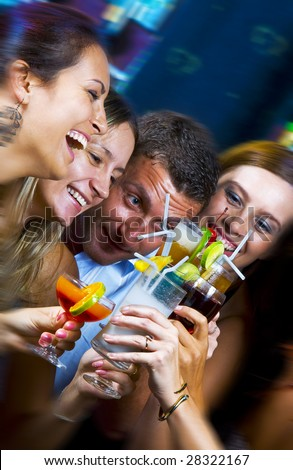 Portrait of young attractive people having fun in night club - stock photo