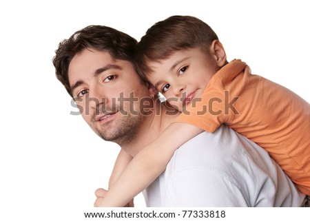 Portrait of young attractive smiling father playing with his little cute son on white background
