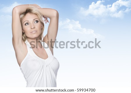 Portrait of young attractive woman having good time  on color back