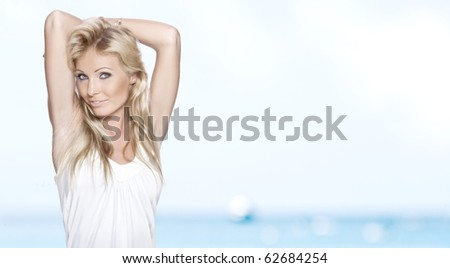 Portrait of young attractive woman having good time  on the beach