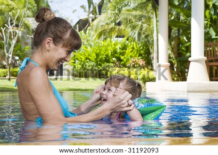 Portrait of young attractive woman having good time with her daughter