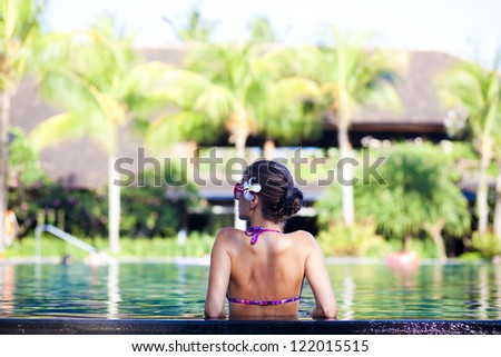 portrait of young attractive woman in luxury pool