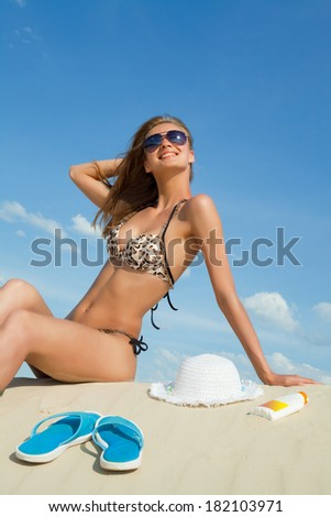 Portrait of young attractive woman on the beach