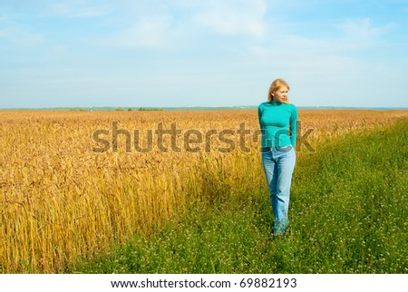 Portrait of young attractive women in the wheat field