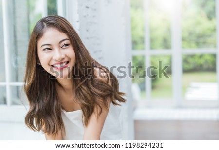 Portrait of young beautiful asian sexy woman relax at home in spring or summer. Smile happy asian girl with perfect clear glow skin face. Lifestyle people education beauty girl next door concept.