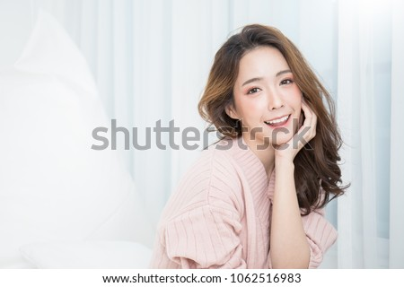 Portrait of young beautiful asian woman relax face in winter bedroom. Sexy beauty girl with healthy makeup facial treatment perfect glow skin. Smile happy asian korean girl isolated white background.