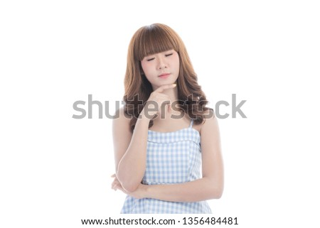 Portrait of young beautiful Asian woman with curly long dark brown hair in light blue checked dress arm crossed body and touch her face in thinking posture, on isolated white background